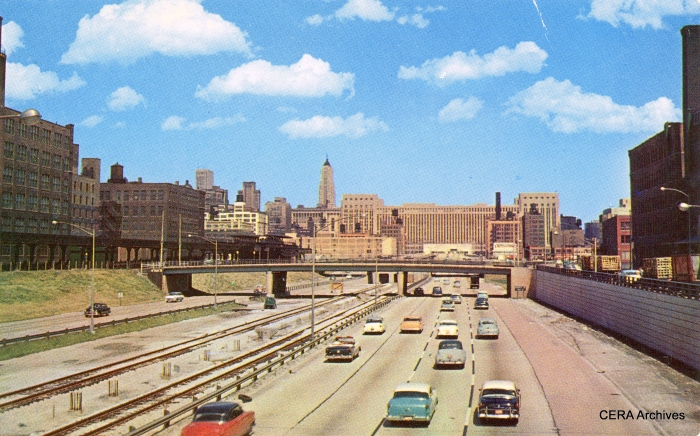 "The Congress Expressway circa 1956-7. Tracks are in the median, but no third rail or stations yet. Meanwhile, the old Garfield Park alignment was still in place, including the double-island Halsted ""L"" station. (Photographer unknown)"