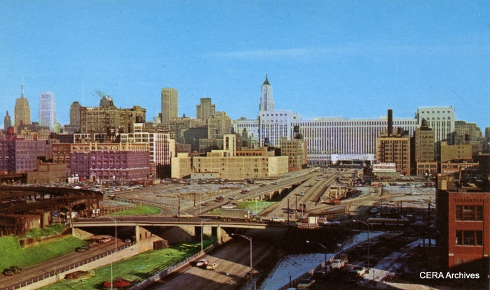 """This picture was most likely taken late in 1956, soon after this portion of the expressway opened to traffic. We are looking east near Halsted. Tracks have not yet been put in the median. The Garfield """"L"""" curves off at left and would continue to operate here through June 1958. (Photographer unknown)"""