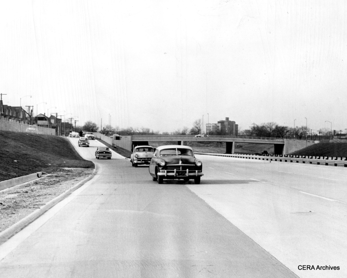 "December 15, 1955: ""Cars enter completed 4 1/2-mile strip of Congress st. expressway at Laramie av. Impatient motorists jumped the gun."" One reason that the expressway could not continue west of here was that the CTA rapid transit line crossed the expressway footprint at grade. We are looking west in this view. (Photographer unknown)"