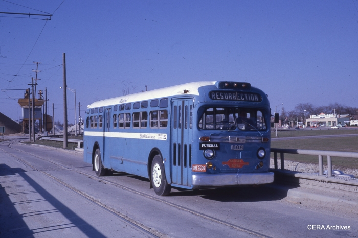Here's yet another mystery photo. Yes, it's a bus, but there seems to be a rail context here in this April 1962 scene. What is going on in this picture? Where is this? (Photo by Charles L. Tauscher)
