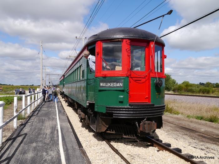 The two-car North Shore train (714-749) stops to pick up passengers along the Main Line. (Photo by David Sadowski)