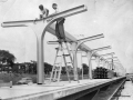 July 1, 1957 - New stations, Congress Expressway and Keeler Ave. Boller Boll and Bill Magorn, iron workers, working on the aluminum support columns at the station. (Photo by Bill Knefel)