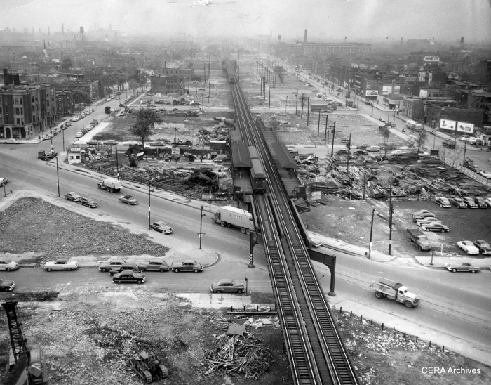 """May 8, 1952 - """"Looking west from Wood along the way of the (Congress) Superhighway."""" (Photo by Joe Kordick) This image was taken just prior to one in part 4 of this series. A two-car Garfield Park """"L"""" train stops at the Ogden station, closely shadowed by a three-car CA&E train, which will also stop there to discharge passengers (instead of at Marshfield, which CTA considered a bottleneck)."""