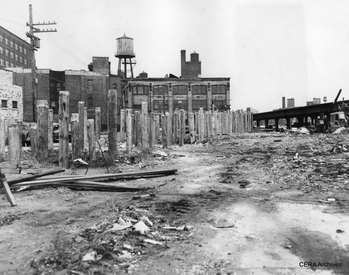 """September 24, 1951 - """"Going ahead with plans for shunting Aurora & Elgin trains and elevated trains to streetcar tracks in Van Buren, between Racine and Sacramento blvd., wooden pilings are driven to support structure bringing the tracks to street level."""" (Photographer unknown) As we know now, CA&E refused to use the Van Buren street-level trackage. Calling it """"streetcar"""" trackage was a bit of a stretch, since ultimately third rail was used and the right-of-way fenced off from traffic. However, calling it that may have been the means used to justify operating trains without crossing gate protection."""
