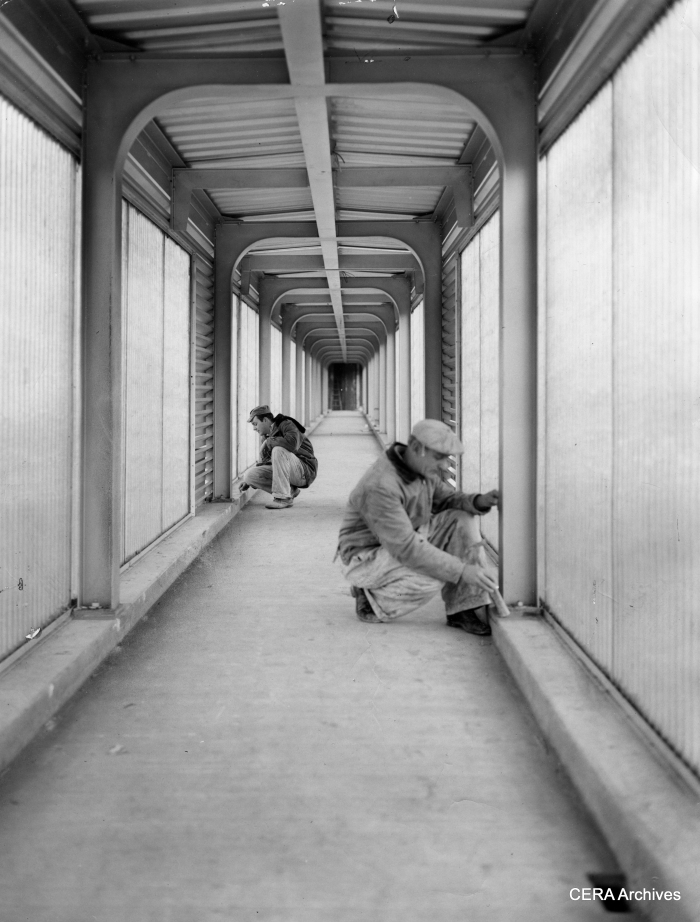 """December 9, 1957 - """"Congress Expy. and Cicero: Dale Mueller, tile setters' helper and Tom Shue, tile setter, work on the inside of the ramp that leads to station."""" (Photo by Knefel) The full-length fiberglass panels on these station ramps soon became a problem, since they shielded anyone in the tunnel from view and were considered havens for crime. Eventually they were partially removed."""