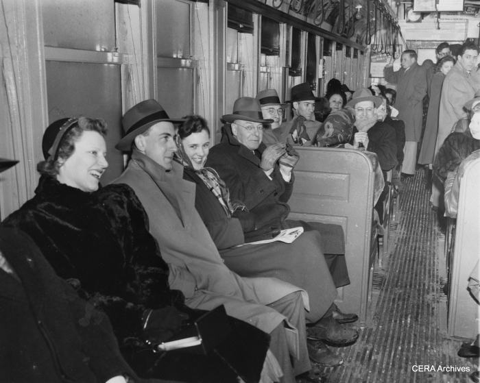 """February 24, 1950 - CTA """"L"""" riders were cheerful despite the obvious lack of amenities on the trains. """"A rush hour crowd shivers aboard an elevated train. They were victims of Chicago's first zero cold snap today, which happened at the same time that the transit authorities cut off all heat in their vehicles to conserve coal. The result: cold customers."""" (Photographer unknown)"""