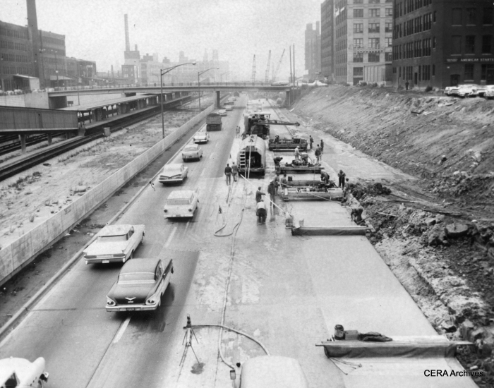 """October 30, 1959 - The old Garfield Park """"L"""" structure, which used to run parallel to the expressway in front of the buildings at the right of the picture, has been out of service for more than a year and has been torn down in this area near Halsted. The space once occupied by the """"L"""", to some extent, allowed the expressway to be widened at this point. (Photographer unknown)"""