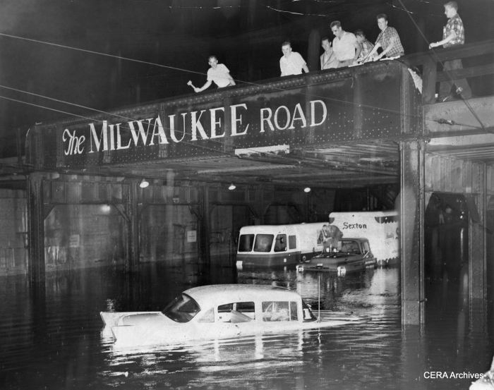 The CTA wasn't alone on July 13, 1957. Here motorists are stranded under the Milwaukee Road viaduct on Cicero avenue near Grand. (Photo by Pauer)