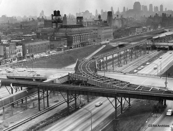 """April 7, 1958 - """"View looking northeast from Paulina and the Congress expressway shows progress of work on a ramp that will link the Douglas Park elevated branch with the median strip of the expressway. The median strip will be used by both Douglas and Garfield trains to enter the Milwaukee-Dearborn subway near Halsted."""" (Photographer unknown) Today, Pink Line trains continue to the left and run downtown over the Lake/Green Line route via the Paulina connector. (Note a CTA train of 6000s in the picture, running on the temporary Van Buren street trackage.)"""