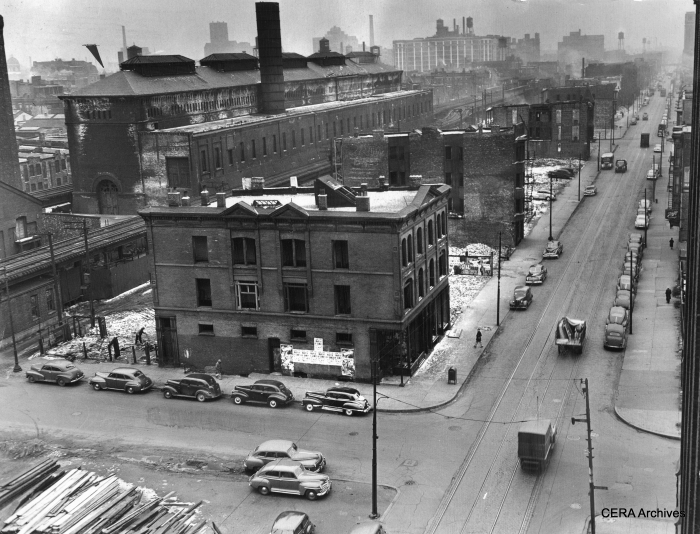 """March 11, 1949 - """"This isn't a London bombed area, but a view of Van Buren st. looking west from Racine av, as demolition continues for the Congress st. superhighway. Vacant areas indicate where wrecking crews already have torn down structures. Other gaunt, vacant buildings have been emptied by the relocation office and will soon fall, including the CTA car barn."""" (Photographer unknown)"""