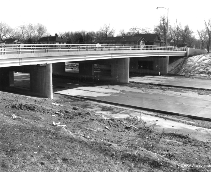 """February 10, 1954 - """"Most of the paving that has been done on the highway has been done in Maywood. This is the scene at 5th av., Maywood, where an overpass crosses the highway."""" (Photographer unknown)"""