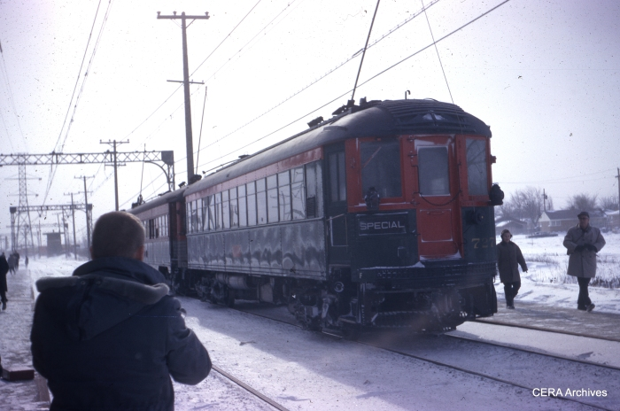 "January 20, 1963, the last full day of North Shore Line operation. ""Waiting for Mundelein-Libertyville train- Solheim's head."" (Photo by Charles B. Porter)"