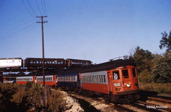 CA&E 427 westbound at Des Plaines in September 1954. A CTA Garfield Park train loops in the background. (Unknown photographer)