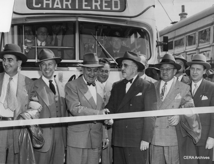 "April 6, 1948 - ""It's a new era- Streetcars are gone from the bumpy Berwyn-LaGrange line and a ribbon is cut at Lombard av. and Cermak rd., to mark the opening of bus service. Henry J. Sandusky, mayor of Cicero and William J. Kriz, mayor of Berwyn, snip the tape as officials of Brookfield, LaGrange and Riverside look on."" (Unknown photographer)"