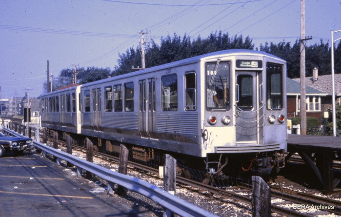 "Mystery Photo #4 - CTA 2200s in September 1973. ""This is the 50th St. station on the Douglas Park Line. The old station building was moved to the Illinois Railway Museum where it can be seen today."" (Charles L. Tauscher Collection)"