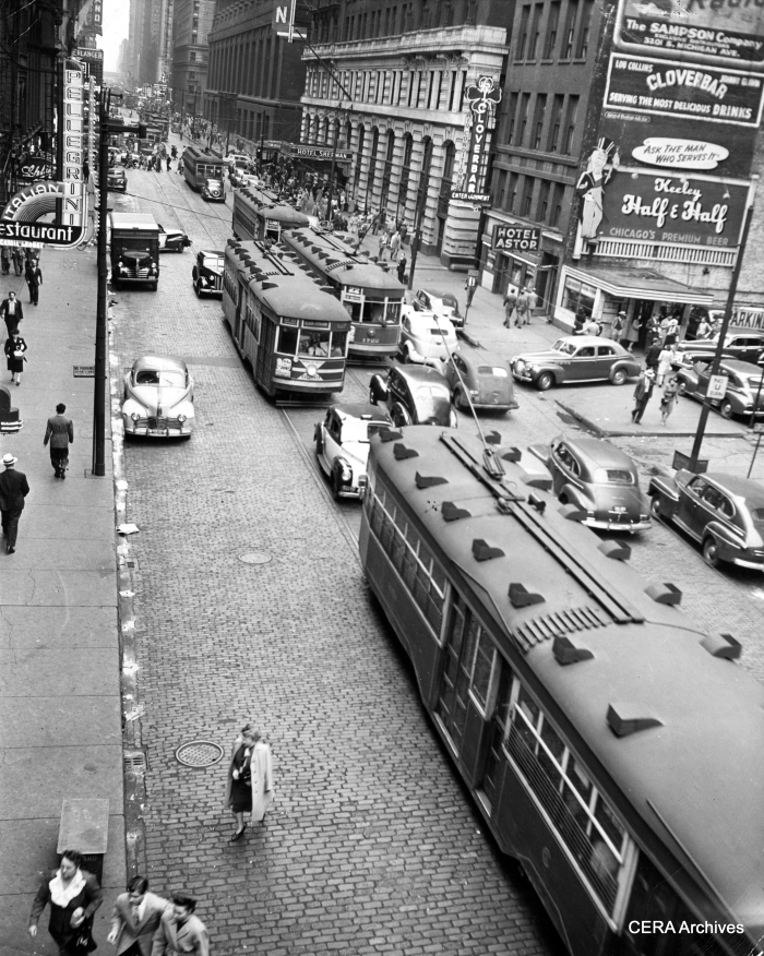 "Mystery Photo #11 - ""Looking south onto Clark St. from the Clark & Lake ""L"" station. The Sedans are still serving Route 22 and my guess is the photo dates from the early 1940s."" (Photographer unknown)"