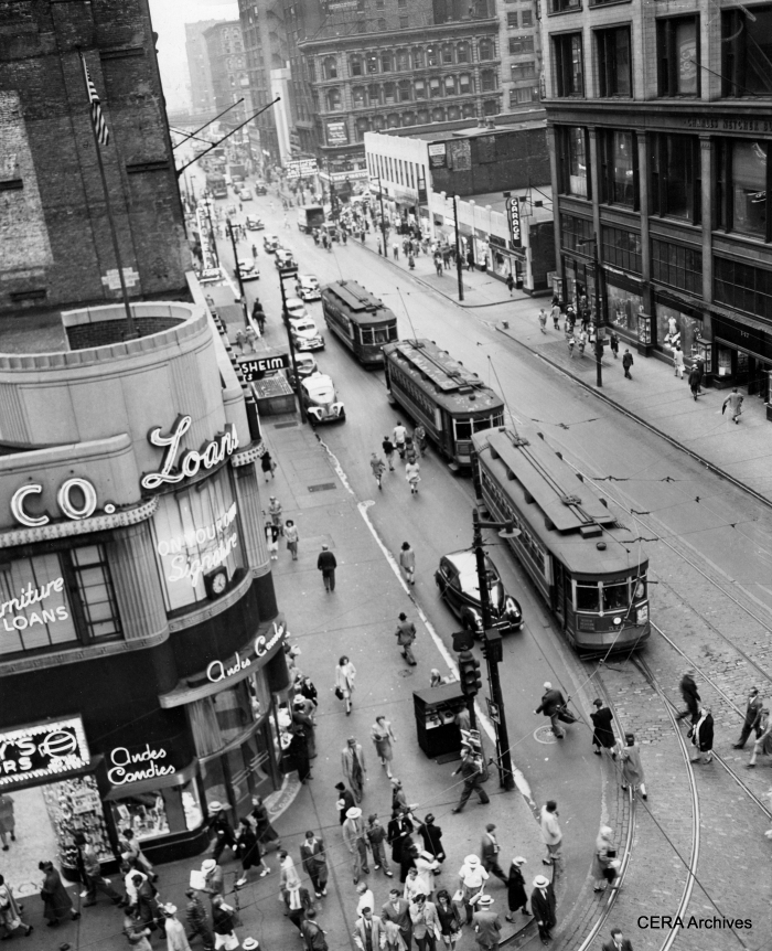 "Mystery Photo #12 - ""Milwaukee Ave. cars line up southbound on Dearborn ready to turn west onto Madison St. Note the ""Charles Netcher Building"" building to the right. Netcher was the founder of the Boston Store which remained in business at that site until 1948 (Sears now occupies the building). As the store fronts still look like the place is open, I'd say the photo was taken no later than 1948."" (Photographer unknown)"
