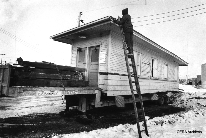 "February 16, 1978 - ""Pete Vesic readies CTA rapid transit station from 50th and Cicero Avenue for its move to the Illinois Railway Museum in Union, Illinois. The former station is on a truck trailer at the National Casting Co., 5300 W. 16th St. It will be dedicated later this year."" (Photo by James DePree)"