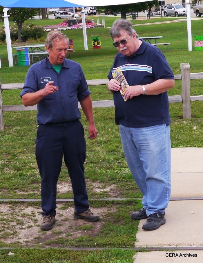 Streetcar technician Bradley Preston chats with CERA President Joe Reuter. (Photo by David Sadowski)