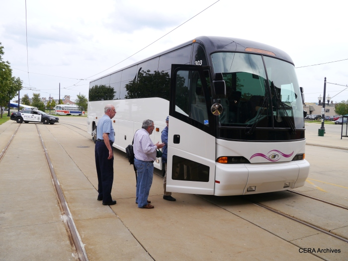 Fans board the CERA charter bus. (Photo by David Sadowski)