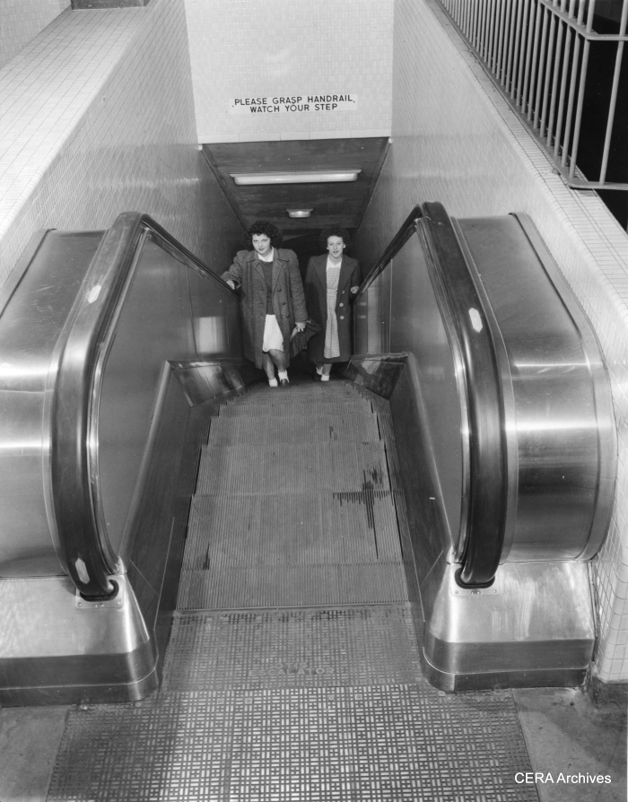 "October 21, 1943 - ""Electric escalators, which can be operated in either direction depending on rush hour needs, are used to speed moving of passengers between train levels and station levels, just below the street surface. Stairways run parallel to the escalators, while walls of passage ways and station levels are of tile."" (Photographer unknown)"