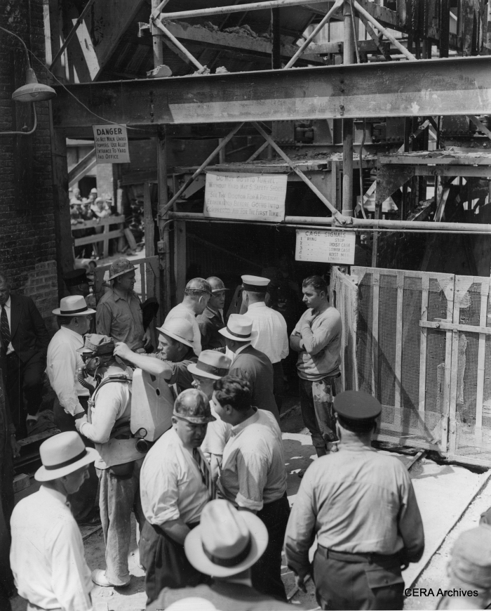 "July 21, 1939 - Subway excavation in the Loop was literally a mining operation: ""Pix shows crowd of workers, subway officials and firemen going down entrance to tunnel."" (Photo by Mosse)"
