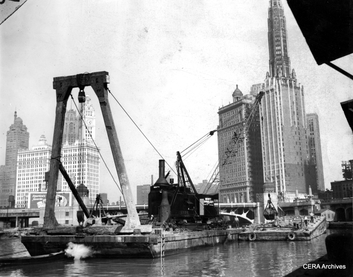 "September 22, 1939 - ""Dredging river for subway at State and Wacker."" (Photographer unknown)"