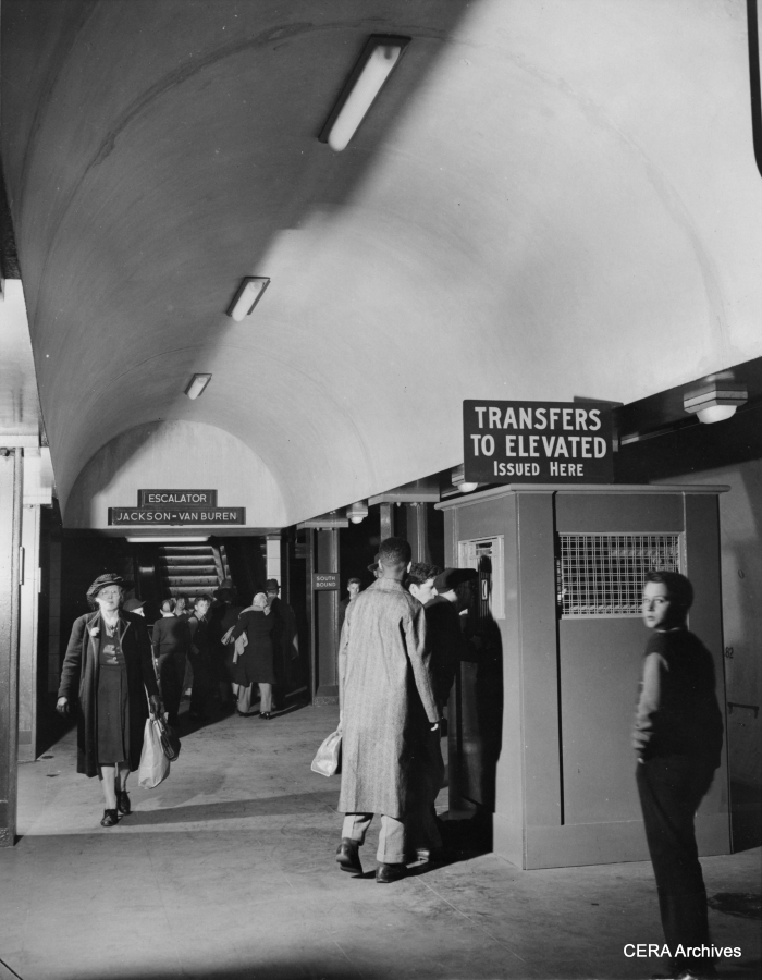 "October 21, 1943 - ""Transfers to allow passengers to switch from the subway trains to westside elevated cars running over the old structure comprising the Loop are issued issued from booths on the train-level platform. Built at two levels, the subway consists of a station level containing ticket seller, automatic turnstiles, checking lockers and washrooms, and the train level."" Eventually, these booths were replaced by machines that issued ""walking transfers."" (Photographer unknown)"
