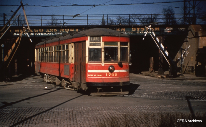 The #16 Lake St. streetcar crossing at Pine. Buses replaced trolleys on this route as of May 30, 1954. (Unknown Photographer)