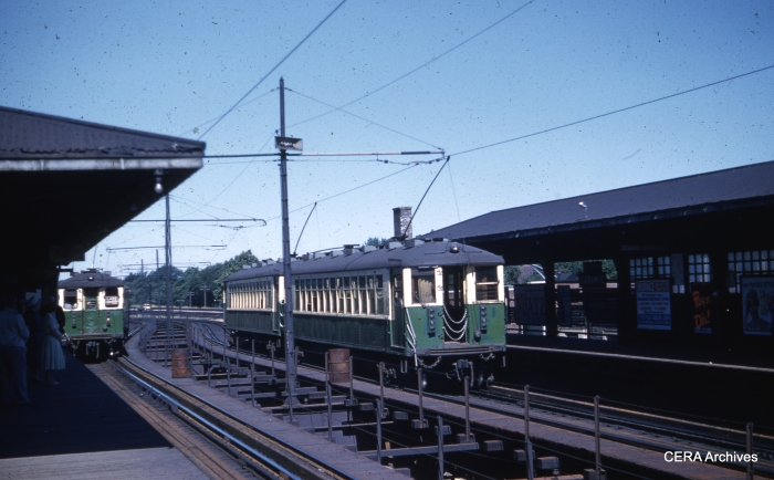 In this July 5, 1960 view, 4000s are switching between third rail and overhead wire. The westbound train at right prepares to descend the ramp to ground-level operation. By the time the new embankment alignment opened in October 1962, CTA had moved the power changeover point west to the Central Avenue station. (Unknown Photographer)