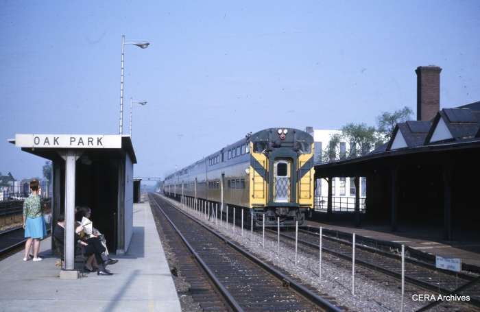 The bi-level is moving towards the camera in this May 1964 scene, since the C&NW runs left-hand. (Unknown Photographer)