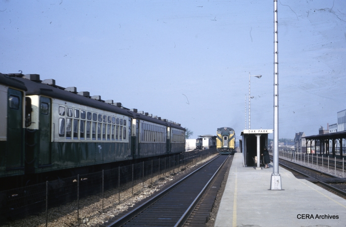 CTA 4000s meet C&NW bi-levels on the embankment in May 1964. (Unknown Photographer)