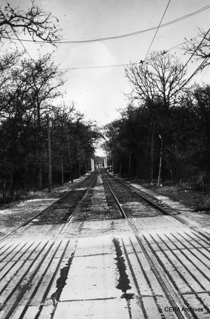 "West Towns private right-of-way through the Forest Preserves. According to Michael Murray, this is ""where the line crossed 1st Ave. just east of the zoo. That photo looks east toward the Des Plaines River crossing and Riverside."" (Photographer Unknown)"