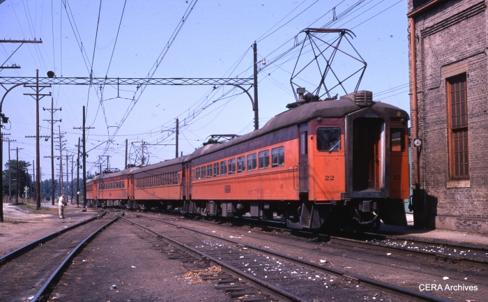 #22 heads up a four-car train in Michigan City in September 1969. (Photographer Unknown)
