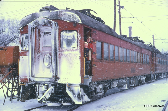 "The caption reads, ""Lance and Carol in snow-covered train, South Bend Yards, February 1969."" (Photographer Unknown)"