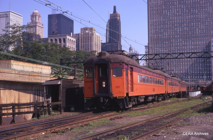 Combine 1010 heads up a train in July 1971. This is the present area of Millenium Park. (Photographer Unknown)