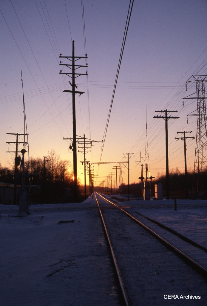 A twilight view of the single-rack right-of-way on January 3, 1978. (Photographer Unknown)