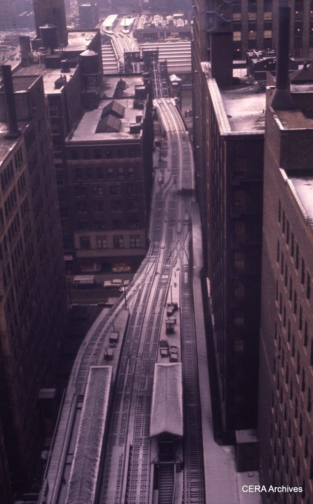 "In this January 1960 view, we see the Garfield ""L"" structure heading west from the Loop, between the time service was discontinued (1958) and when the structure was torn down (1964). From the track arrangement, it would appear that one of the two bridges over the Chicago River was taken out of service sometime between the end of CA&E operation downtown (1953) and the rerouting of CTA service through the old Wells Street Terminal to a new connection with the Loop ""L"" structure. Other parts of the old Garfield ""L"" were torn down in 1959. (Photographer unknown)"