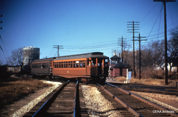 A train of CTA wood cars crosses the B&O just east of DesPlaines Avenue, at the current site of the Eisenhower expressway. (Photographer unknown)