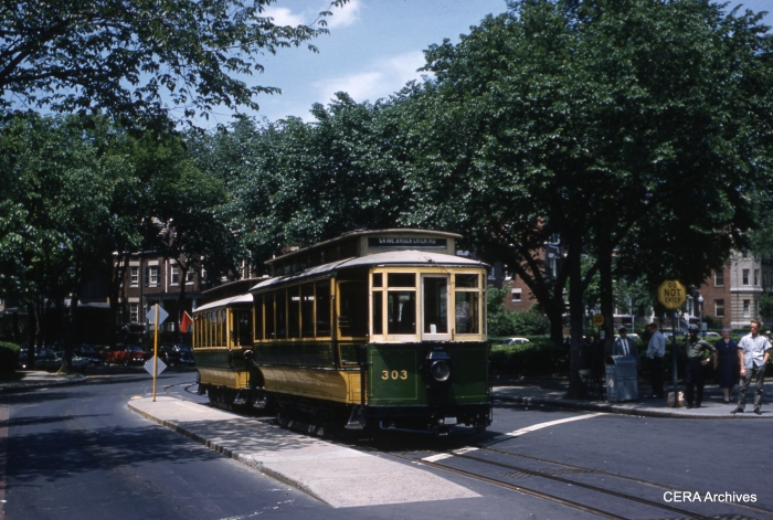 Former Capital Traction 303 is pulling trailer 1512 in this May 21, 1961 view at Mt. Pleasant Loop. Car 303 is on display at the Museum of American History. (Photographer unknown)