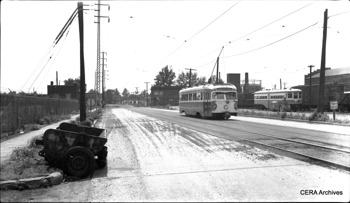 View looking south showing car #451 on Madison Avenue, just south of 17th Street in Granite City, Illinois, showing street resurfacing work, on June 3, 1956. Car 451 was built by the St. Louis Car Co. in 1949 and is now preserved at the Connecticut Trolley Museum. (Photographer unknown - CERA Archives)