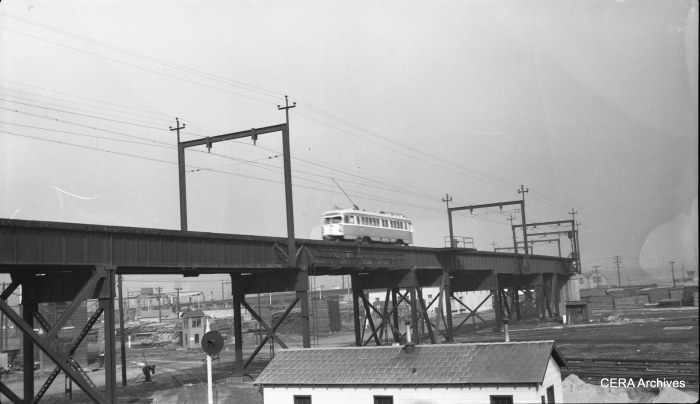 View looking northeast from Hall street, showing a PCC car on the elevated structure parallel to North Market Street east of Hall Street in St. Louis in 1954. (Photographer unknown - CERA Archives)