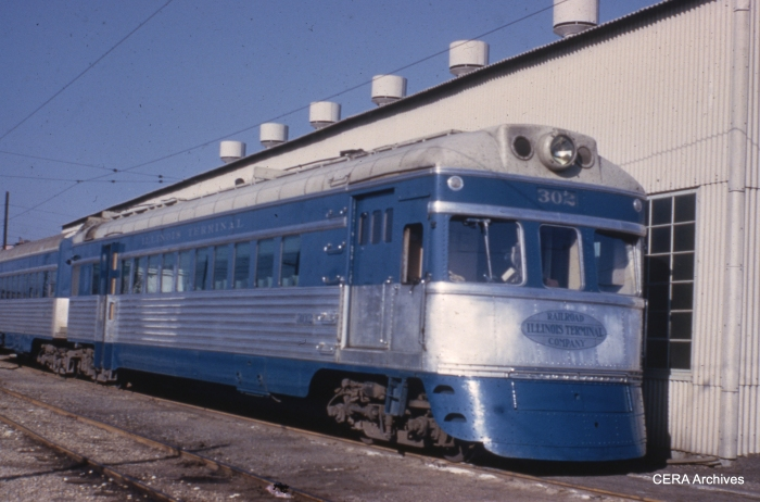 IT streamliner 302, coupled to deluxe dining car 352. They were built by St. Louis Car Co. in 1947-48. (Photographer unknown - CERA Archives)