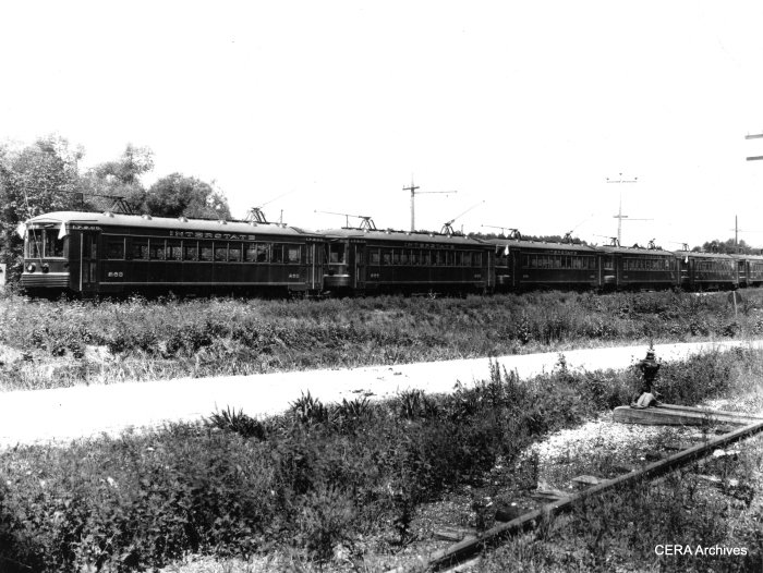 "A line of cars headed up by Interstate Public Service car 263. Interstate was one of the predecessor companies to Indiana Railroad. According to Don's Rail Photos, ""263 was built by Kuhlman Car Co in 1927, #924. It became IRR 202 in 1930 and sold as Portland Traction Co 4001 in 1940. It was acquired by Northern California Trolley Museum in 1959 and Western Railway Museum in 1960. It was restored as IRR 202."" A note on the back of the photo says these cars were used in the Jeffersonville, Charlestown, and New Albany area. (Photographer unknown - CERA Archives)"