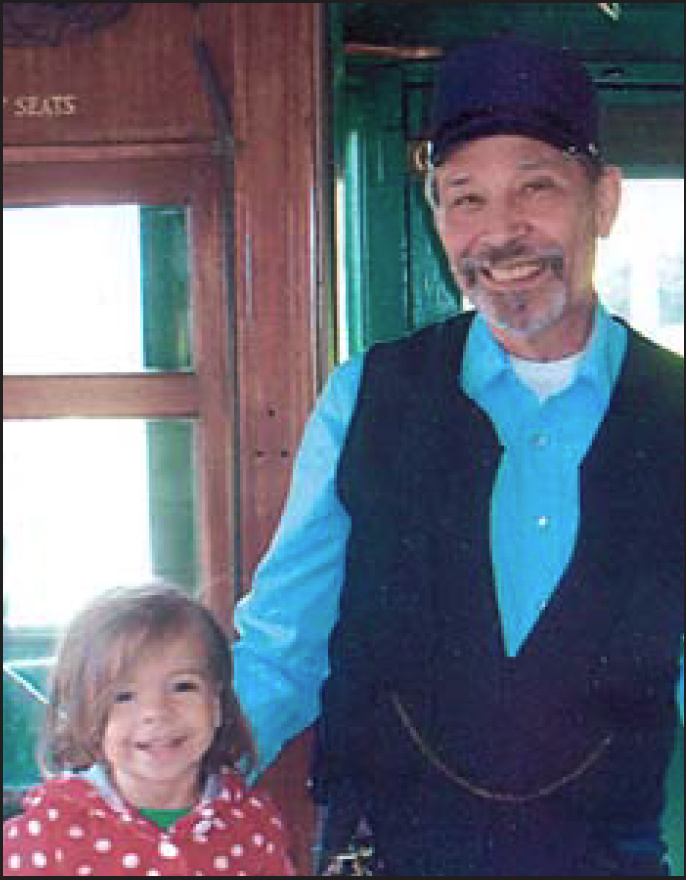 John Marton with one of his beloved grandchildren, in a picture he chose to include in last year's CERA publication Trolley Sparks Special #1.
