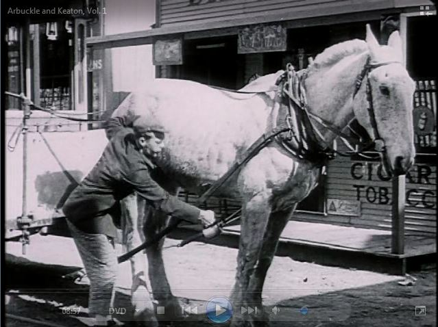 "Al St. John oils a horse in ""The Bell Boy"" (1918)."