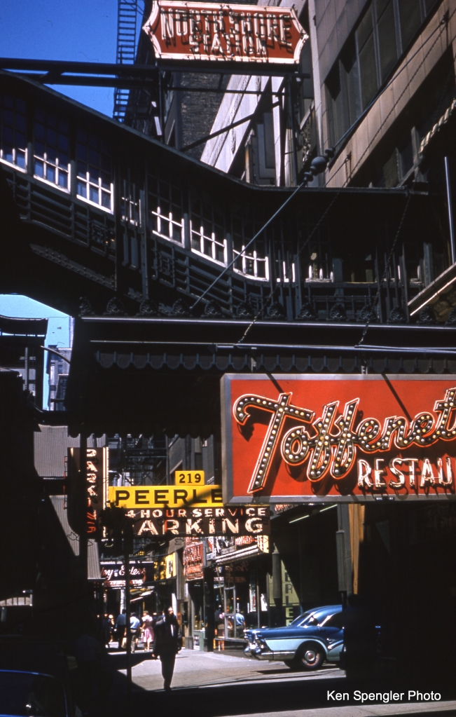 A classic view of the North Shore Line downtown terminal at 223 S. Wabash in the late 1950s. A two-tone blue 1957 Buick Century drives into the Peerless parking garage. Nearby, Dario Toffenetti's restaurant offered a simple menu of food prepared well, at affordable prices. (Ken Spengler Photo)