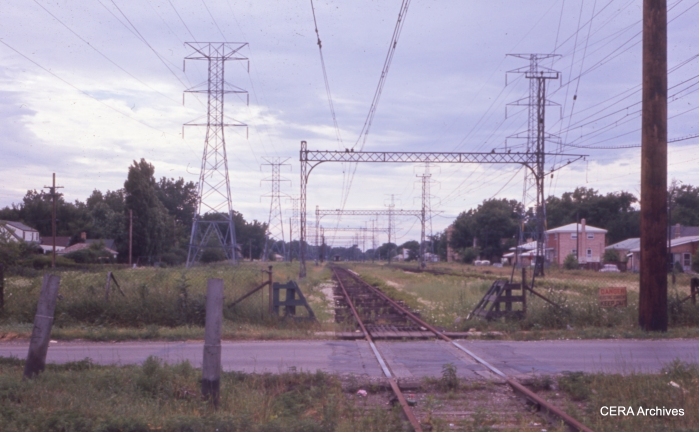 The derelict North Shore right-of-way at Crawford Avenue in July 1963. The wire is up, but the rails are rusty after not having been used in several months. (CERA Archives)