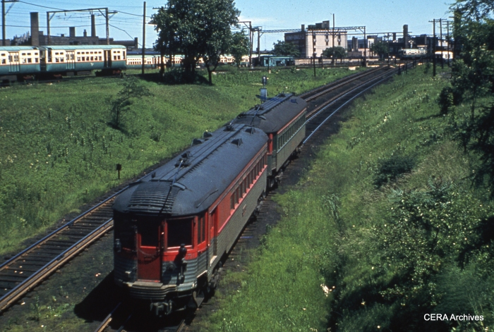 "CNS&M ""Silverliner"" 251 (now preserved at the Illinois Railway Museum) is at the rear of a two-car train approaching Howard. (CERA Archives)"