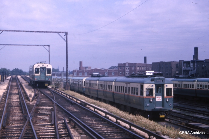 A CTA single car unit in Evanston service heads southbound approaching the Howard terminal in this July 17, 1965 view. One of the 51-54 series articulated cars used on the Skokie Swift is parked in the yard. (CERA Archives)